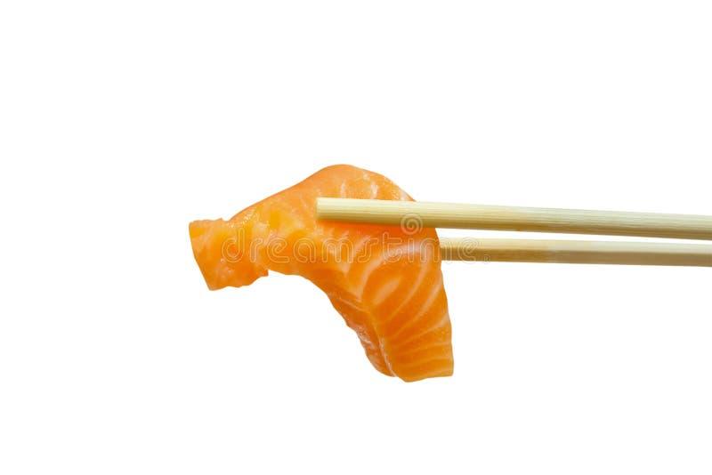 Salmon sashimi with chopsticks isolated on white stock image