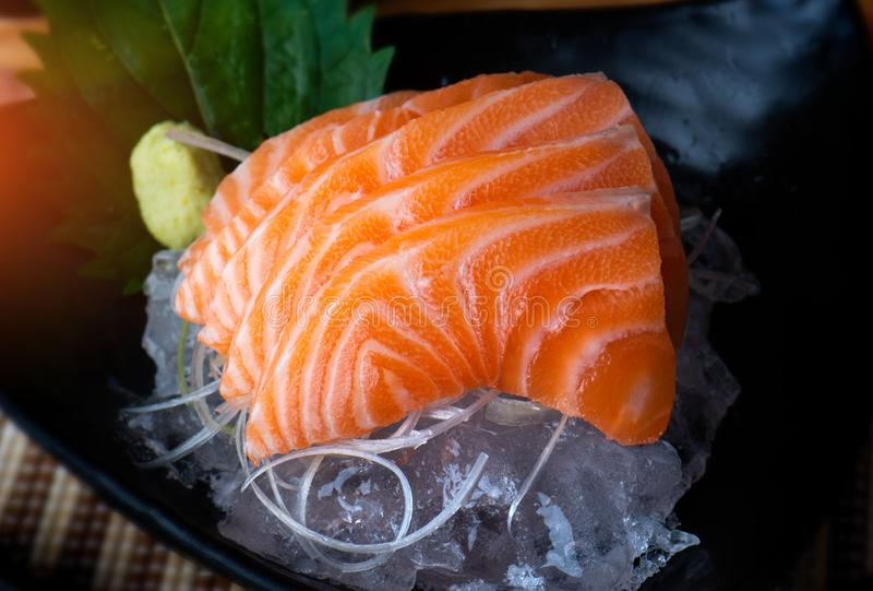 Salmon sashimi cutting and surve. Salmon sashimi cutting and surve raw salmon fish in Japanese style food royalty free stock image