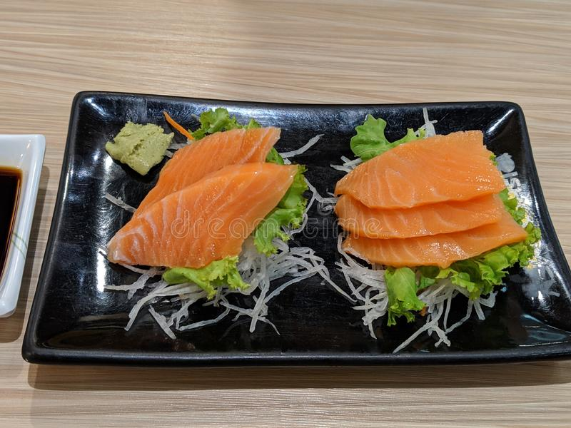 Salmon sashimi dish stock images