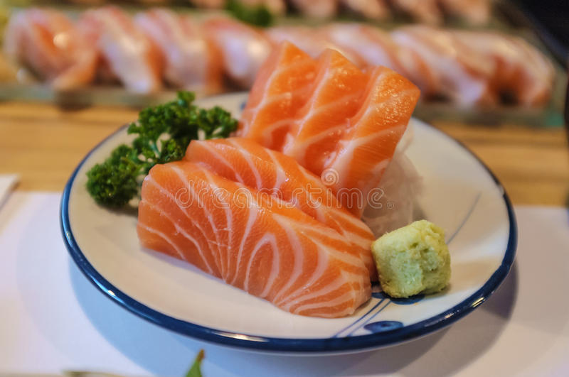 Salmon Sashimi. Fresh salmon sashimi served in traditional Japanese restaurant royalty free stock photo
