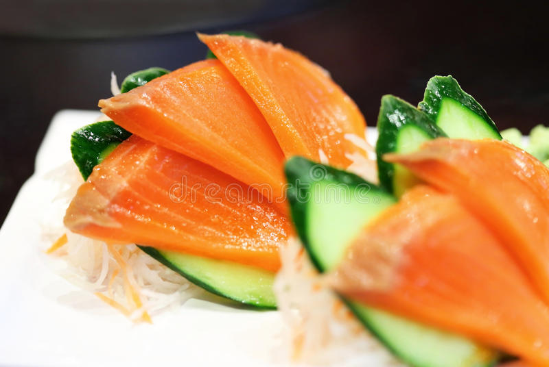 Salmon sashimi. Fresh salmon sashimi with vegetable stock photo