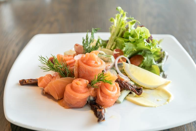 Salmon sashimi salad. Salmon sashimi with potato salad stock photo