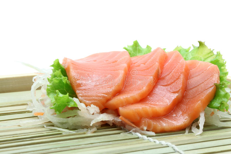 Salmon sashimi salad. Fresh salmon sashimi salad on bamboo dish stock photography