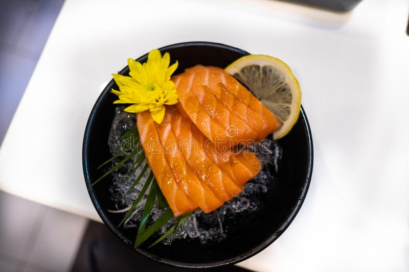 Salmon sashimi. Seafood, fish, gourmet, raw, sushi, japanese, meal, asian, plate, cuisine, healthy, delicious, fresh, traditional, slice, restaurant, ginger royalty free stock photography