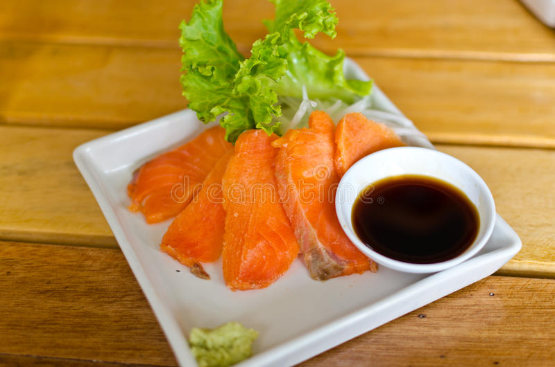Salmon Sashimi. With sauce and wasabi, Japanese food stock images
