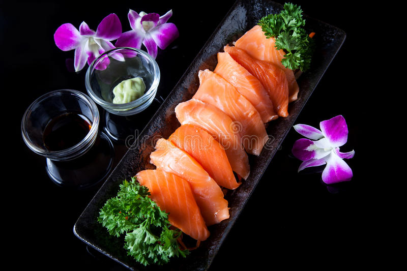 Salmon sashimi. Served with soy sauce and wasabi stock image