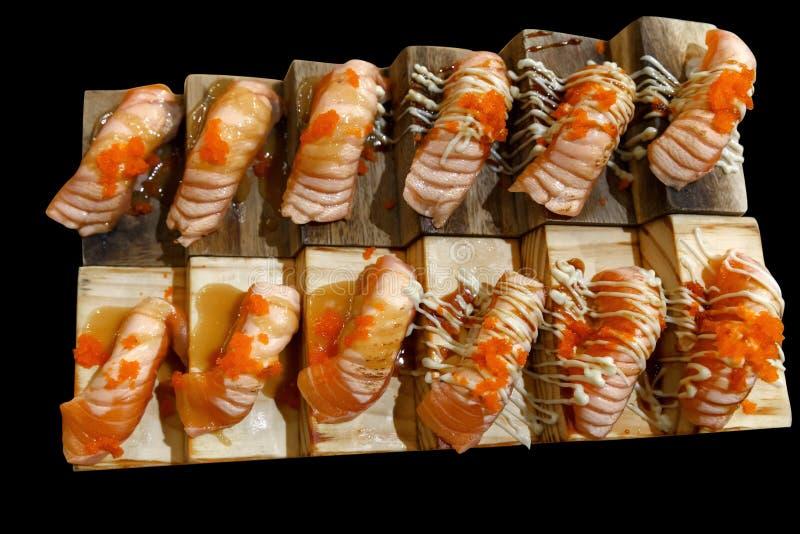Salmon Sashimi and shrimp roe. Raw salmon on stair. Traditional from Japan Salmon Sashimi and shrimp roe on wood presentation royalty free stock images