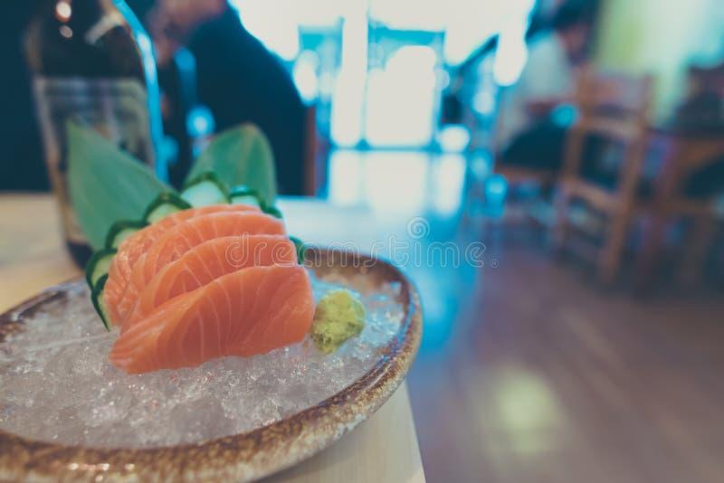 Salmon sashimi sliced in janpan style dish. Vintage tone Image of Japanese cuisine raw and fresh salmon sashimi sliced in janpan style dish royalty free stock photos
