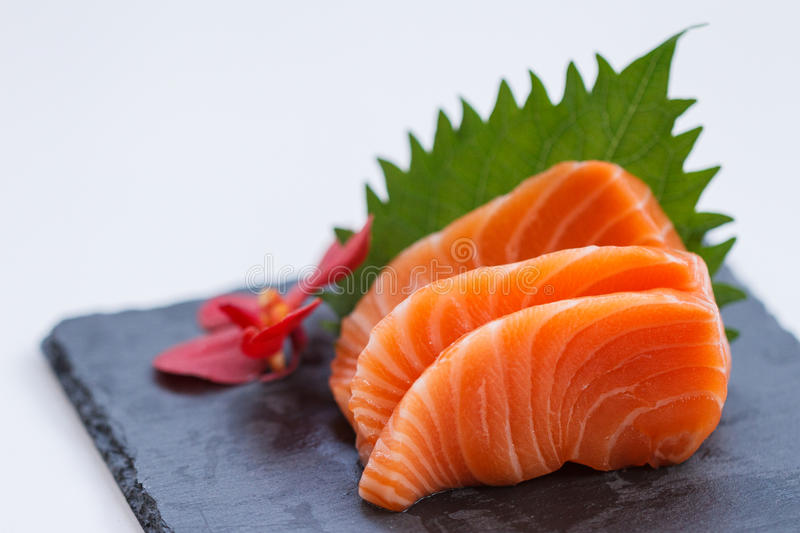 Salmon Sashimi : Sliced Raw Salmon Served with Sliced Radish on Stone Plate stock image