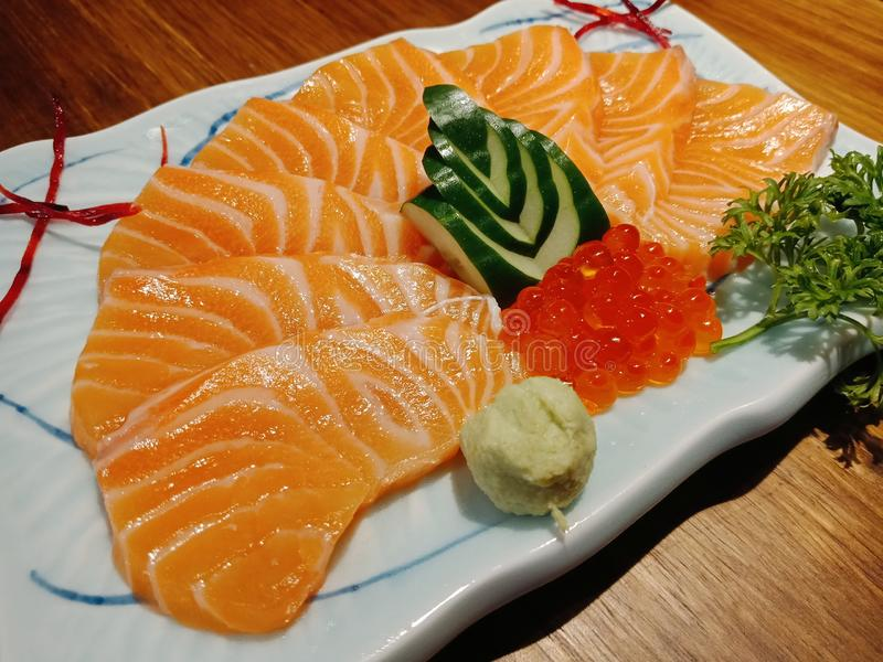 Salmon sashimi. Soft, tender tongue and bow with sweet salmon eggs royalty free stock photography