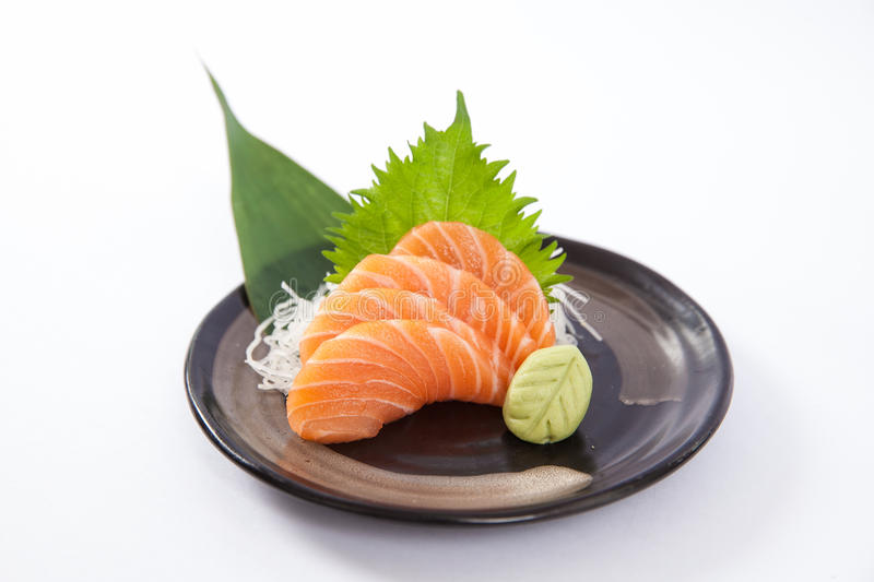 Salmon Sashimi. Thin slices of salmon sashimi on a plate stock photos