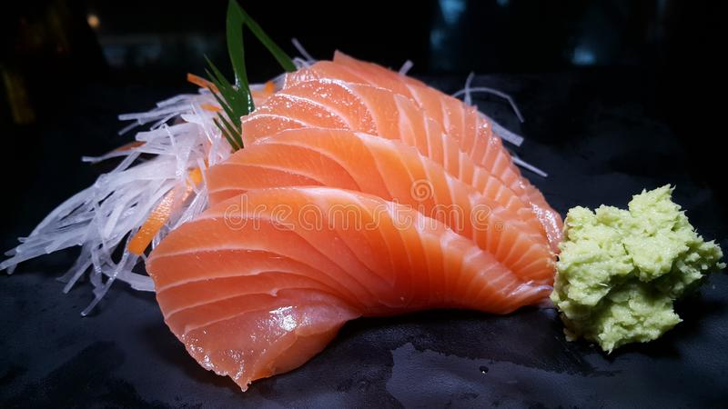 Salmon sashimi. With wasabi on decoration dish stock photos