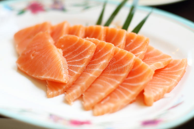 Salmon sashimi. On white plate royalty free stock photography