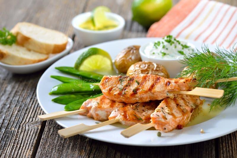 Salmon skewers royalty free stock photo