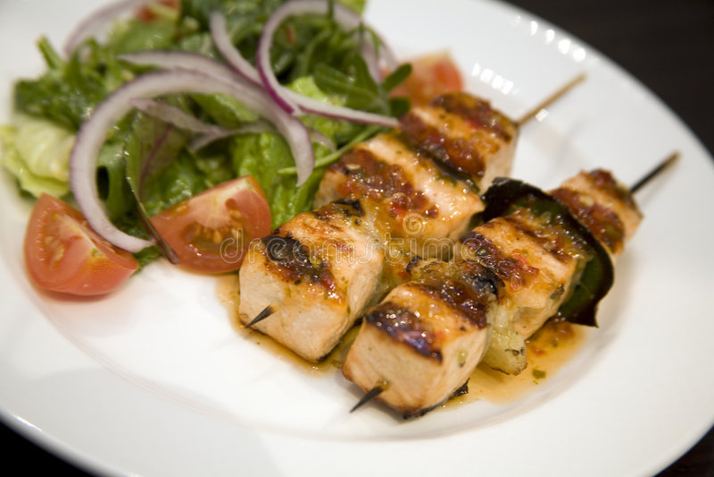 Salmon On Skewers With Salad Stock Image