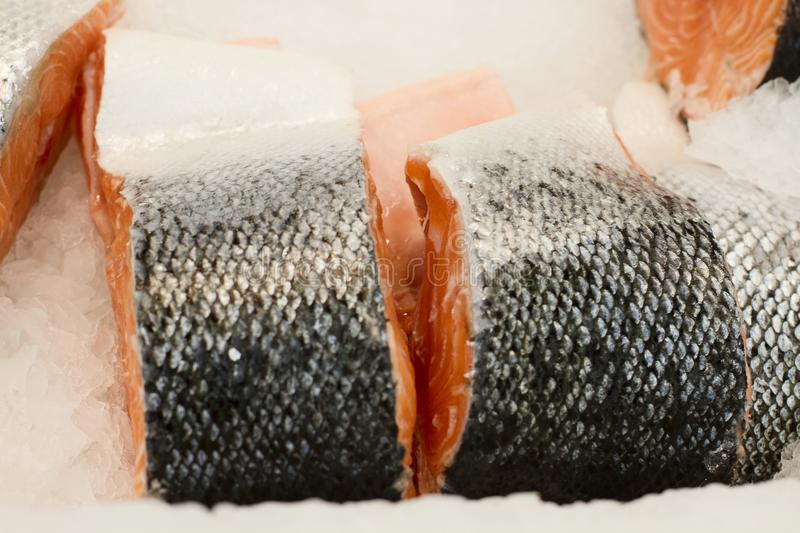 Salmon slice in supermarket. piece of fish in ice at restaurant kitchen. Fresh fish fillet. Healthy food for sushi.Top view. Mock royalty free stock images