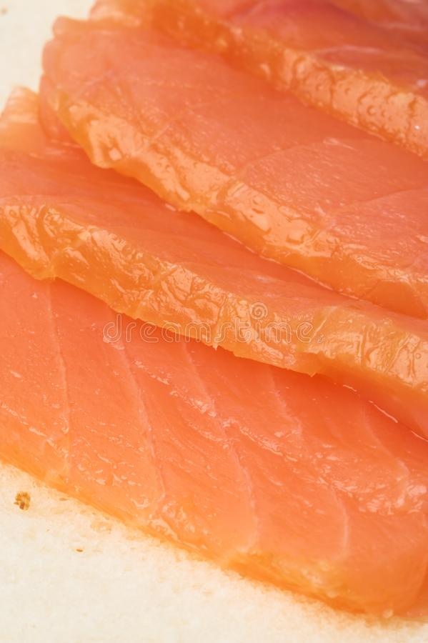 Salmon slices stock images