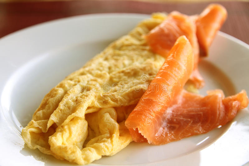 Salmon slices and French omelette royalty free stock photo