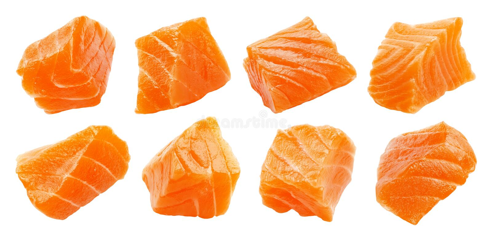Salmon slices isolated on white background with clipping path, cubes of red fish, ingredient for sushi or salad stock photo