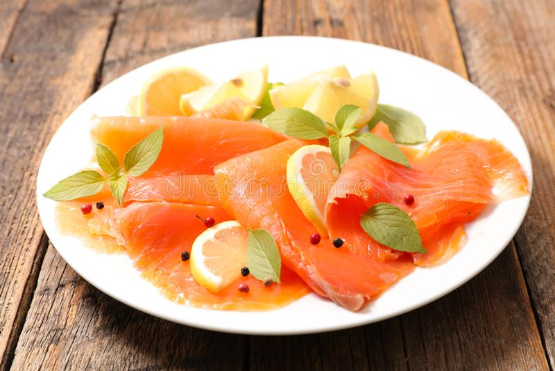 Salmon smoked. Slices with lemon stock photography