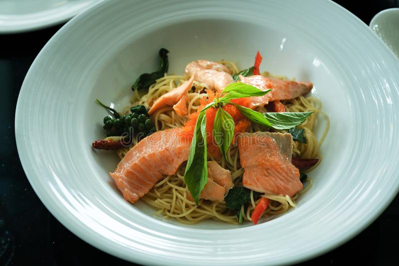 Salmon spaghetti, smoked salmon and shrimp egg with spicy Thai herb. Home made food. Concept for a tasty and healthy meal, top. View stock image