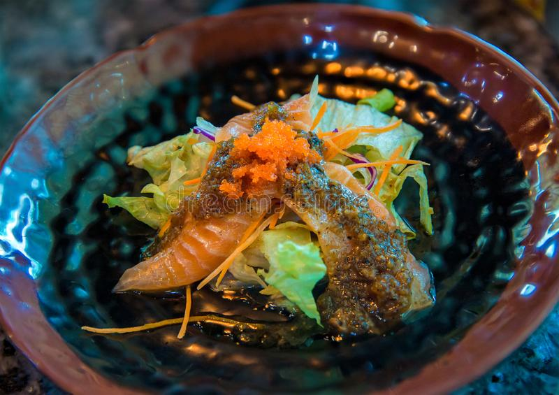 Salmon spicy salad. Japanese and thai fusion food. image for background, royalty free stock photography