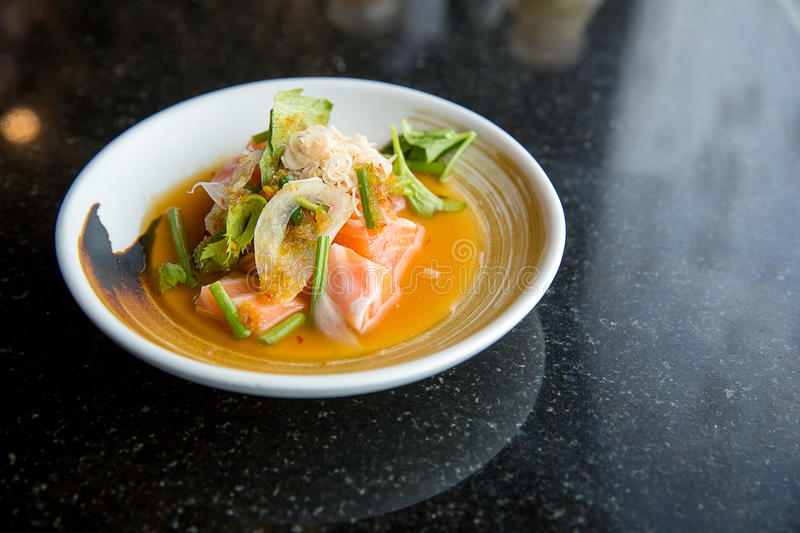 salmon spicy salad. Japanese and thai fusion food. image for background royalty free stock photography