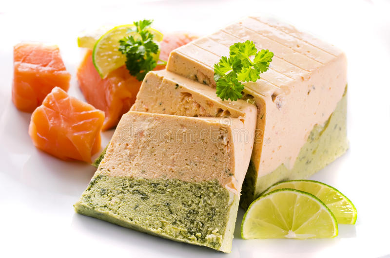 Salmon and Spinach Terrine. As closeup on white background stock photos