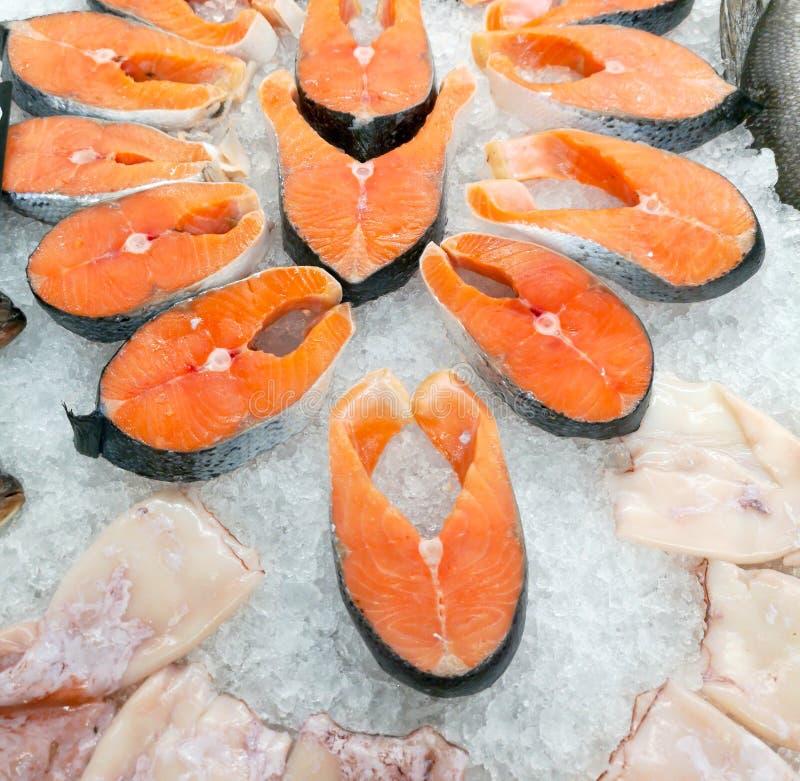 Salmon steak in ice on a market shelf.  stock photos