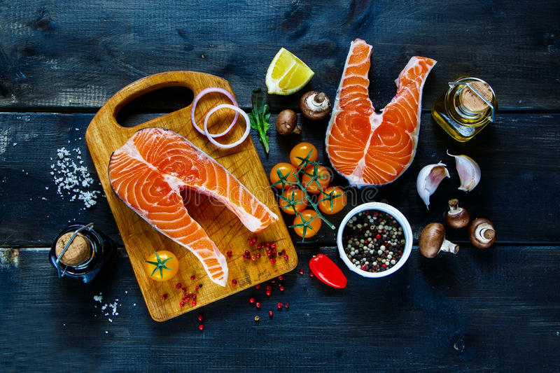 Salmon steak with ingredients stock image