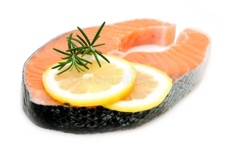 Salmon steak with lemon royalty free stock image