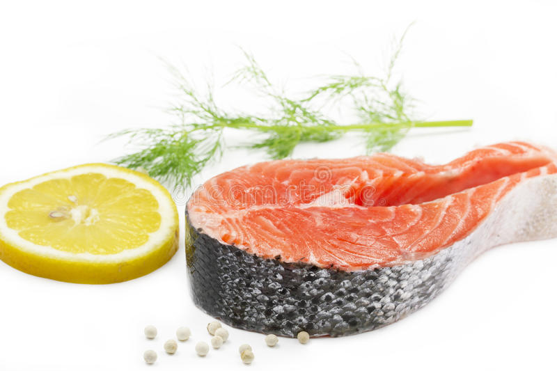 Salmon steak with lemon and dill stock photos