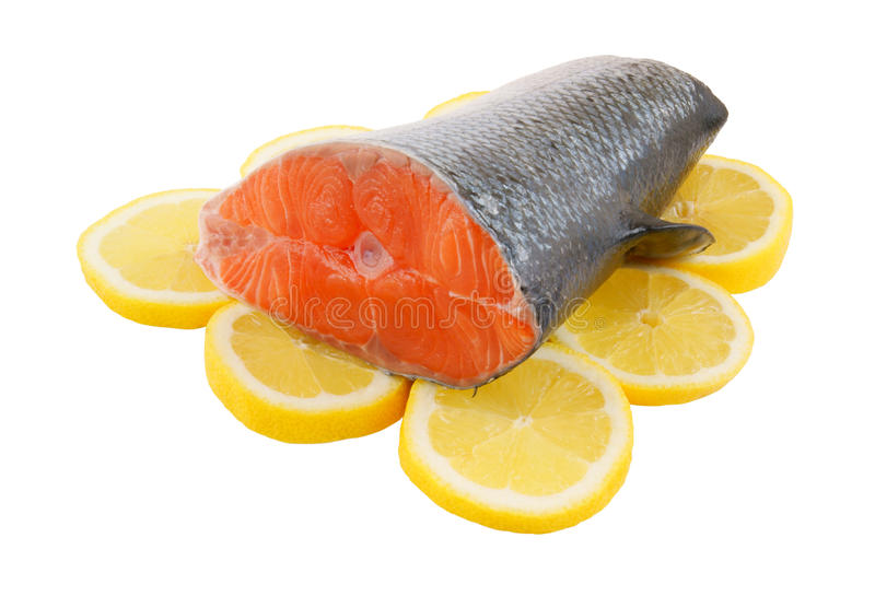 Salmon steak with lemon isolated stock images