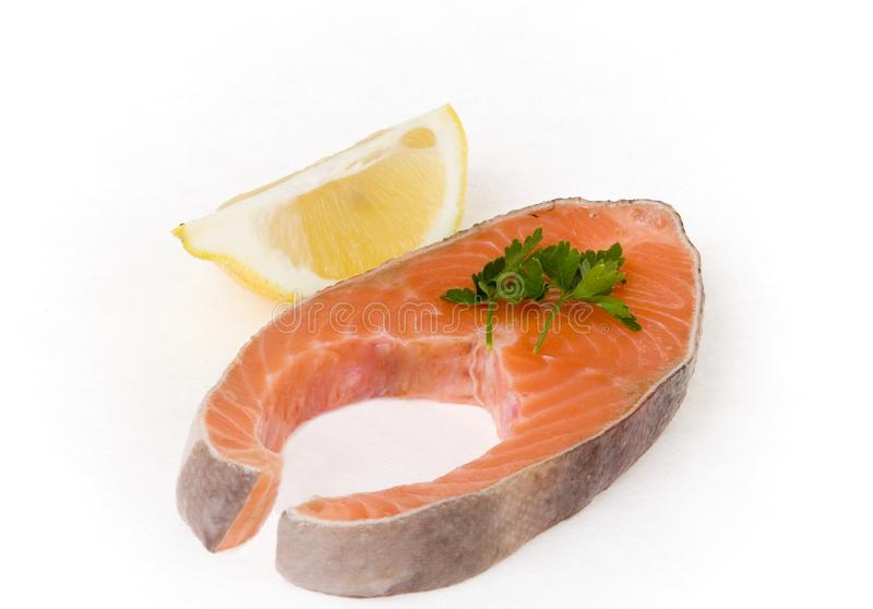 Salmon steak with lemon segment stock photo