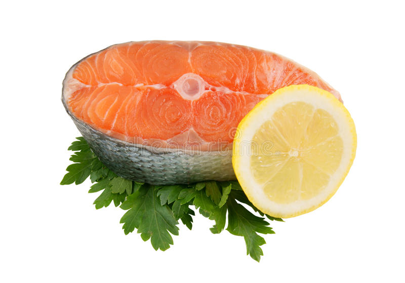 Salmon steak with parsley and lemon royalty free stock images