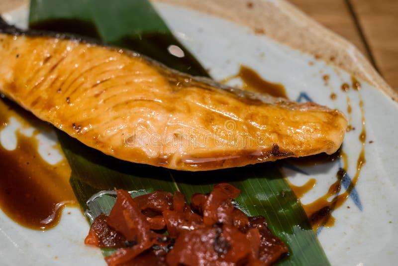Salmon steak with teriyaki sauce stock image