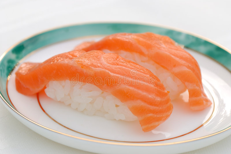 Salmon Sushi. Pink Salmon Sushi on a plate stock images