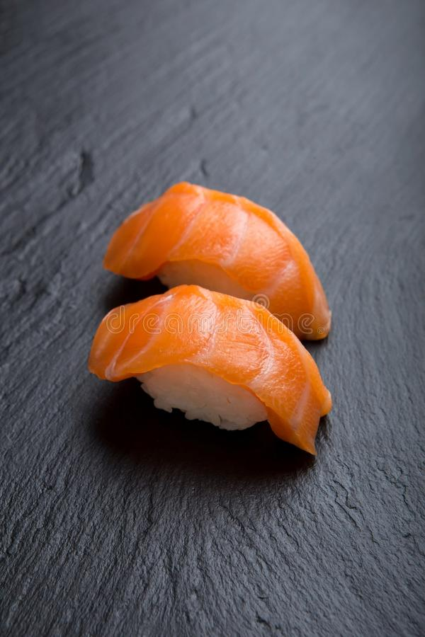 Salmon sushi on a black royalty free stock photography