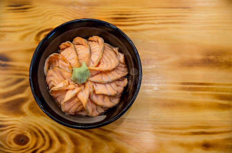 Salmon sushi don. Salmon sashimi, salmon`s egg ikura, shredded radish and slice ginger with rice. stock photo