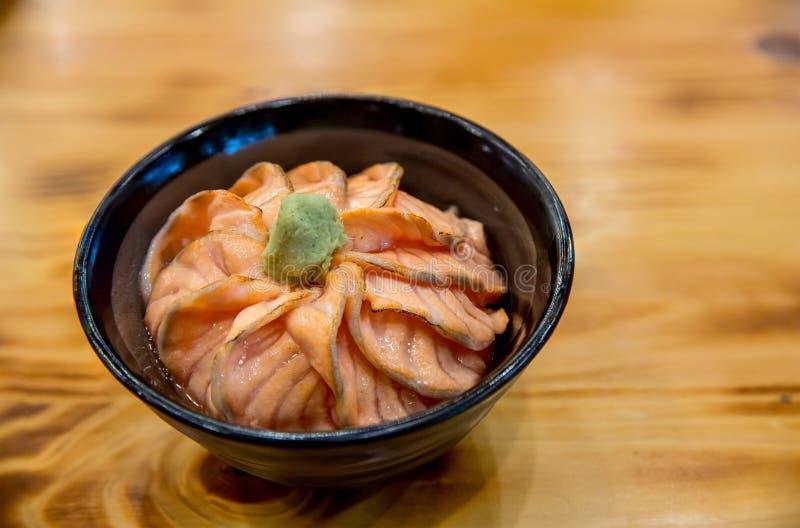Salmon sushi don. Salmon sashimi, salmon`s egg ikura, shredded radish and slice ginger with rice. stock photography