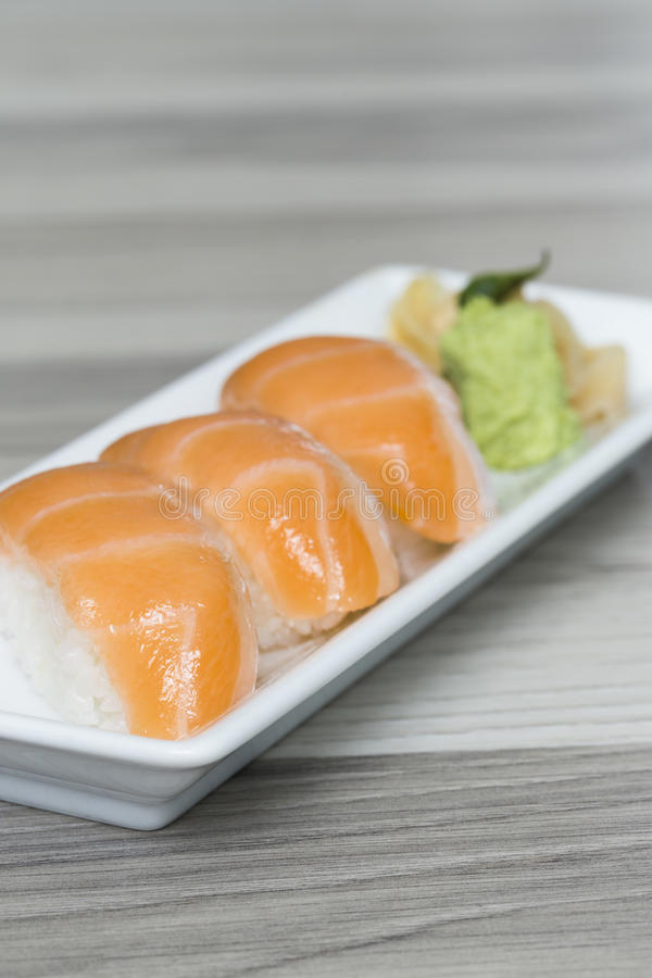 Salmon sushi with wasabi stock image
