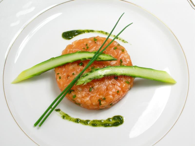 Salmon tartar with asparagus stock image