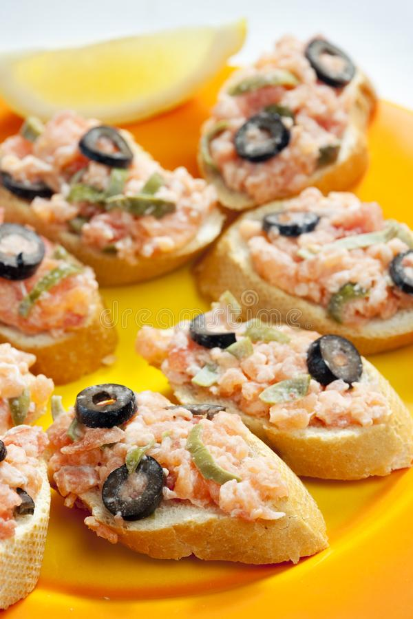 Salmon tartare with capers and black olives. Inside, indoor, indoors, interior, interiors, gastronomy, cuisine, foodstuff, aliment, aliments, meal, meals royalty free stock photography