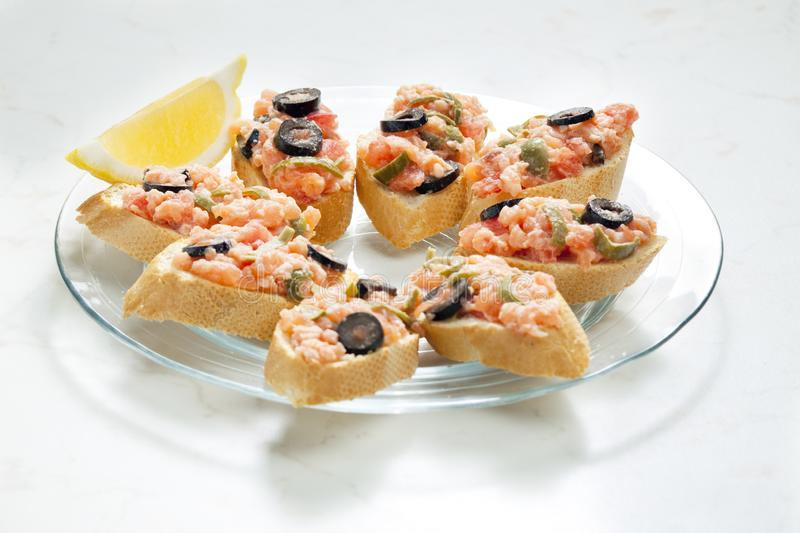 Salmon tartare with capers and black olives. Inside, indoor, indoors, interior, interiors, gastronomy, cuisine, foodstuff, aliment, aliments, meal, meals royalty free stock images