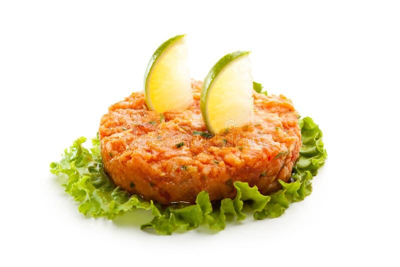 Salmon Tartare. On Salad Leaf with Lime Slice stock photos