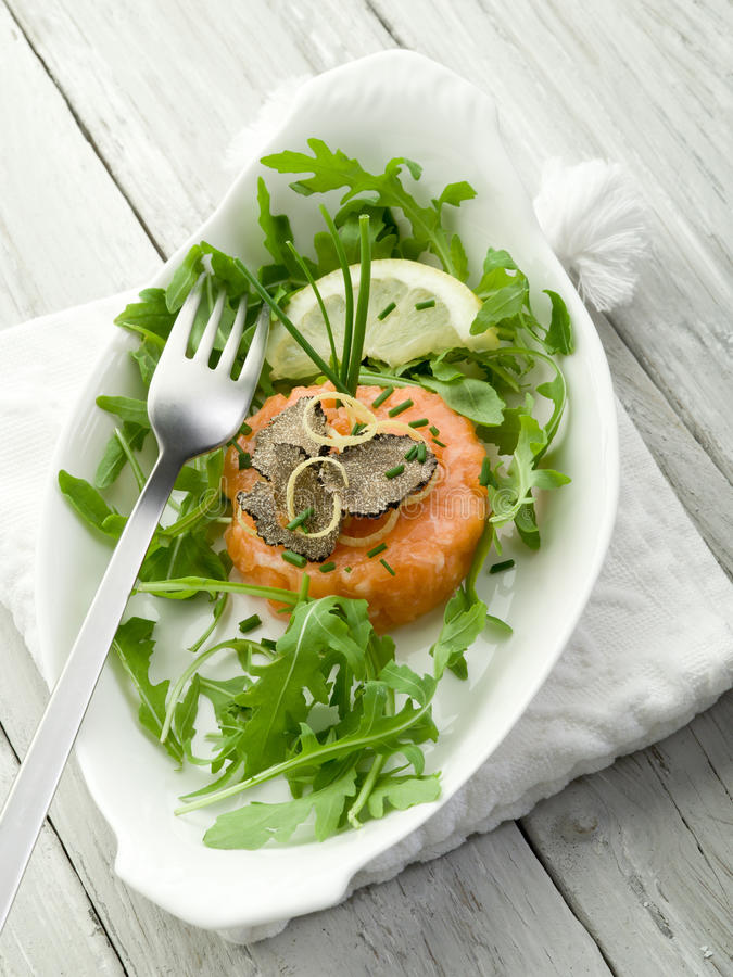 Salmon tartare with truffle stock photo