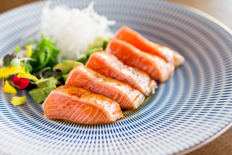 Salmon tataki dinner close-up. royalty free stock photography
