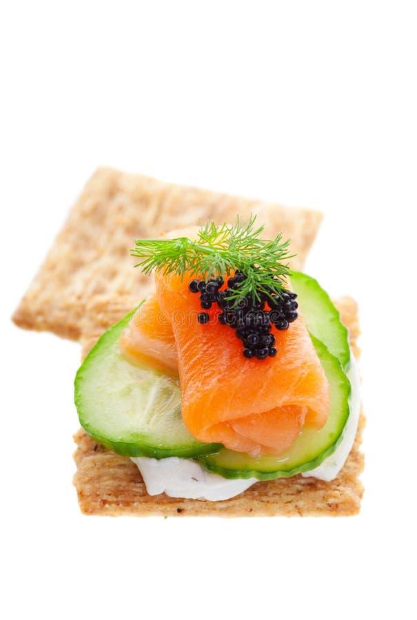 Salmones con el caviar imagen de archivo