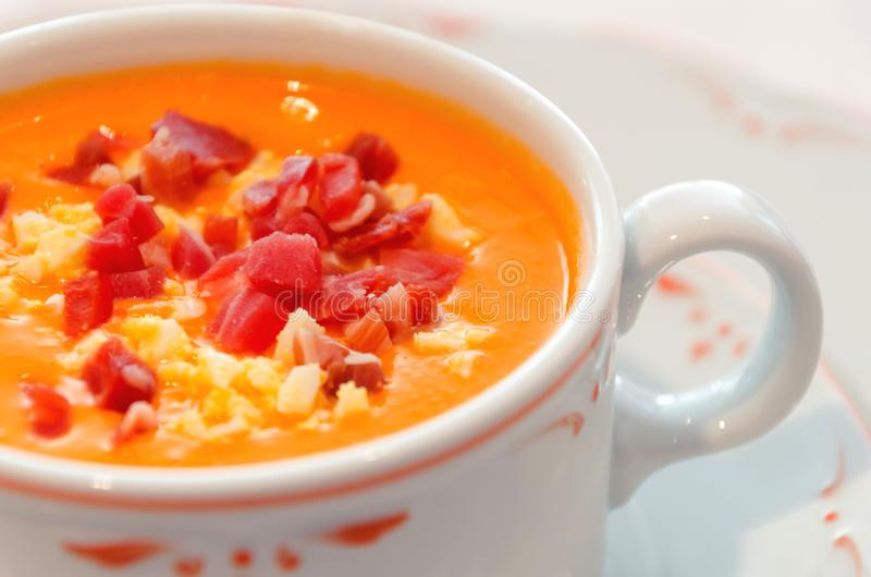 Salmorejo cordobes cold soup or puree made with tomato, bread, o. Salmorejo served with serrano ham and boiled egg. Typical andalusian cold soup or puree made stock images