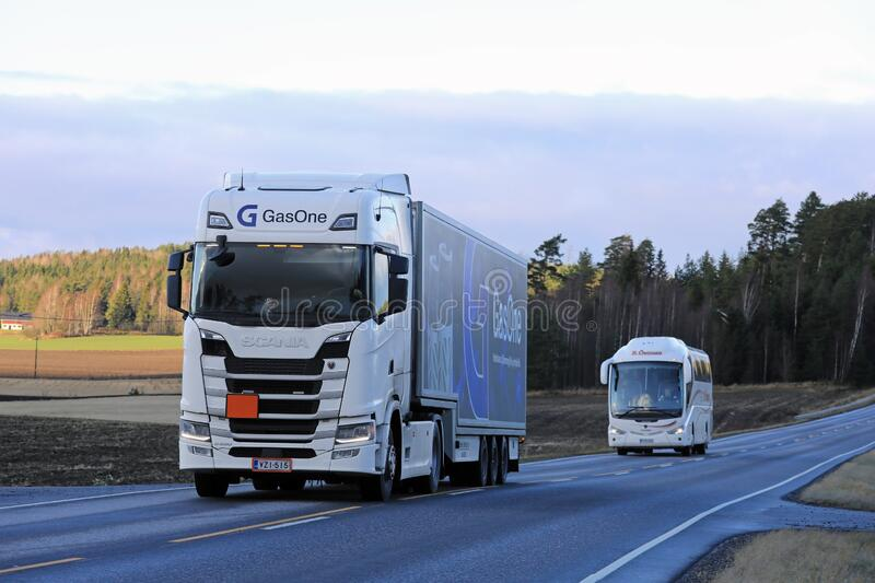 Scania Semi Truck and Bus on the Road stock image